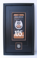 Photo of a commemorative Harley Davidson pin and ticket with a US  background.